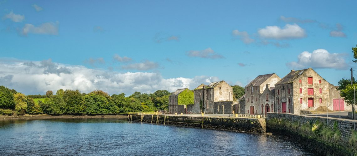 This is a picture of the old warehouses along the river front in Ramelton in Donegal, Ireland